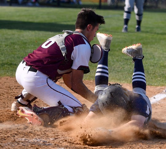 Gettysburg catcher Dylan Ed gets the tag on Chase Hoecke of Dallastown as he slides safely to the plate during  YAIAA baseball championship, Thursday, May 16, 2019.