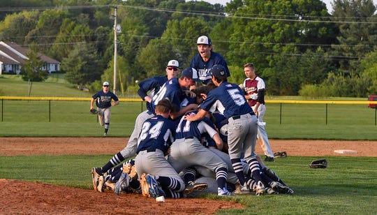 The Dallastown players celebrate their York-Adams League baseball playoff championship on Thursday.