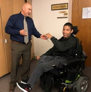 Lyon County School District Superintendent Wayne Workman presents Jesse Rojas with a scholarship.