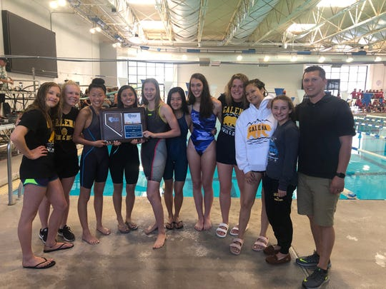 The Galena girls swim team  with the first place trophy on Saturday. From left to right, Annabelle Linzy, Isabelle Auger, Emma Karam, Julie Abrigonde, Summer Murphy, Chasmyn Quinata, Kathryn Clewett, Kelly Henley, Casey Brichetto, Bricole Burns, coach Angel Skelton.