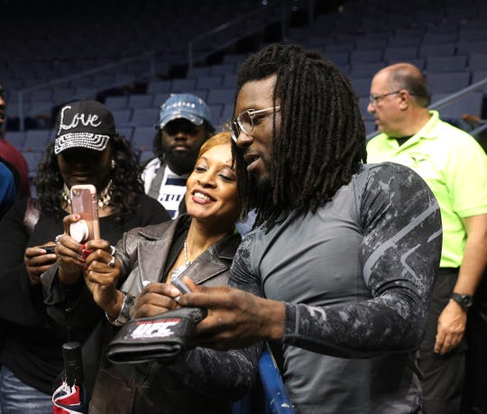Henrietta's Desmond Green posed for pictures and siged autographs for fans, friends and family after a public workout before Saturday's UFC event at the Blue Cross Arena.