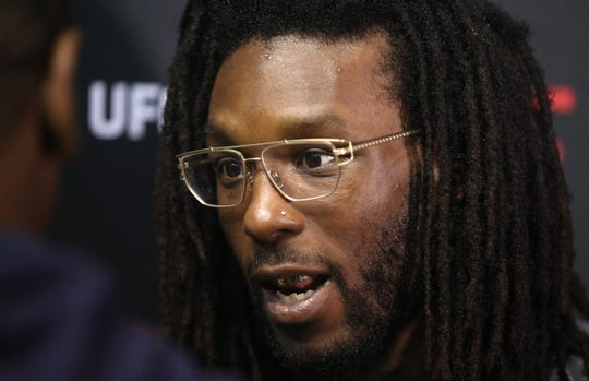 Rush-Henrietta graduate Desmond Green speaks with the media after a workout. Green will on the card for Saturday's MMA event at the Blue Cross Arena.