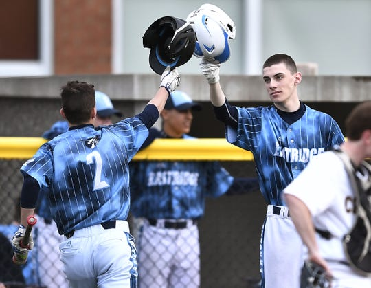 Eastridge's Brady Booher, right, congratulates Jayden Fayad on scoring the Lancers' sixth run against Honeoye Falls-Lima during a game at Eastridge High School, Wednesday, May 15, 2019.