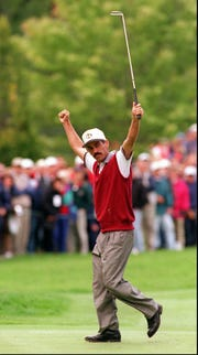 Corey Pavin sinks a long birdie putt on the first hole of Saturday's afternoon matches at the 1995 Ryder Cup at Oak Hill Country Club.
