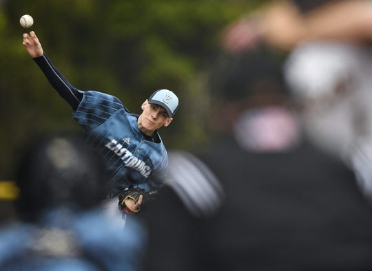 Eastridge's Brady Booher delivers a pitch against Honeoye Falls-Lima during a game at Eastridge High School, Wednesday, May 15, 2019. Eastridge won, 7-6.