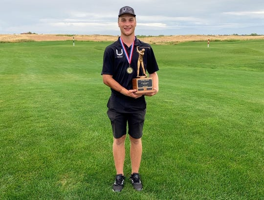 U-Prep golfer Mark Stephens poses with the individual championship trophy after taking first place at the boys Northern Section Masters at The Links at Rolling Hills on Tuesday, May 14, 2019.