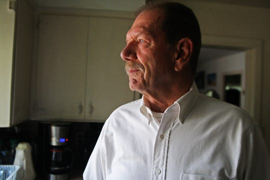 Veteran Rick Davis stands in his kitchen. He is facing a misdemeanor for registering his deceased father to vote. May 16, 2019.