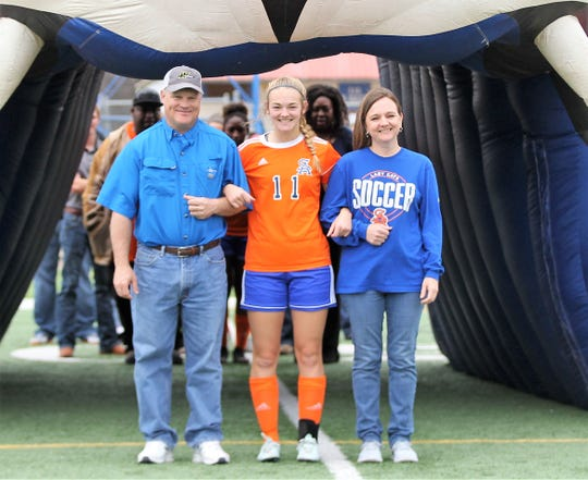 San Angelo Central High School soccer player Madison Mayben is pictured with her parents on Senior Day during the 2019 season. Mayben will be playing for Lubbock Christian University next season.
