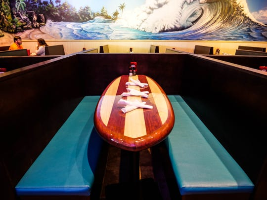 Every table at Nalu Rehoboth is shaped likea surfboard and was custom-made in California by Serendipity Surfboards.