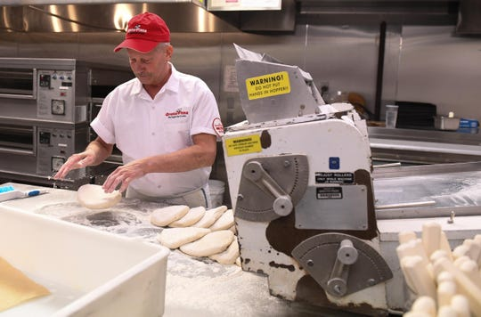 Bob Hiltebeitel, has been with the company 29 years, prepares the dough at Grotto's pizza on Tuesday, May 14, 2019 at the Grand Slam in Lewes, Del.
