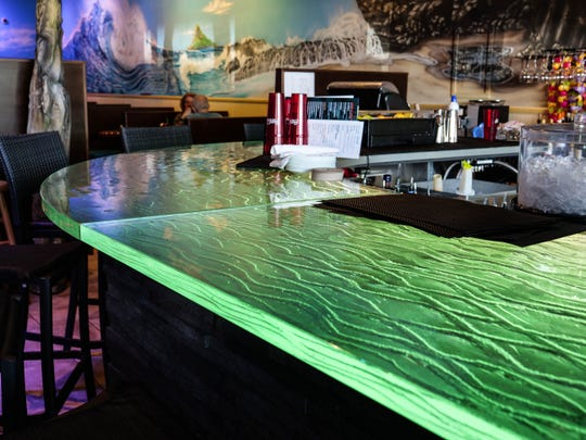 Nalu Rehoboth has a 2,000-pound crystal bar that slowly changes color from an LED strip.