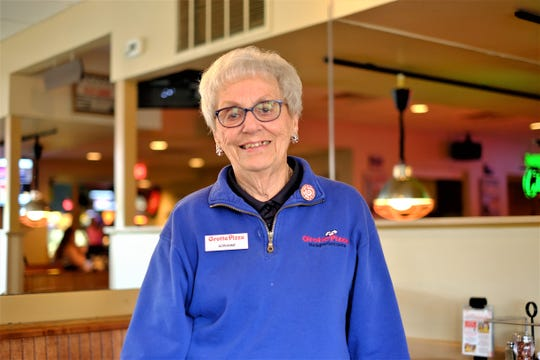Adrianne Trala, a self-described people person, started working at Grotto Pizza in 1990. She is one of several longtime Grotto Pizza employees.