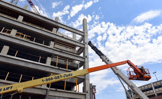 Construction continues on the parking garage portion of the Village on the River development Thursday, May 16, in downtown Sioux Falls. The project agreement was recently terminated.