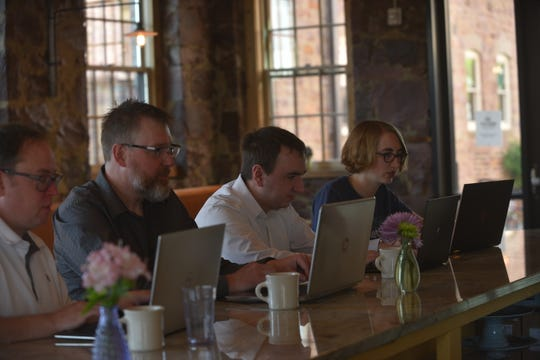 From left, MarketBeat's Ryan Quam, Will Bushee, Matt Paulson and Rebecca McKeever work on laptops at Queen City Bakery in Sioux Falls.  MarketBeat, an online tool for individual investors, forecasts $9 million in revenue in 2019, nearly triple of what the company brought in a couple of years ago.