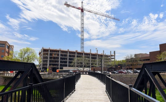 Construction continues on the parking ramp portion of the Village on the River development Thursday, May 16, in downtown Sioux Falls. The project agreement was recently terminated.