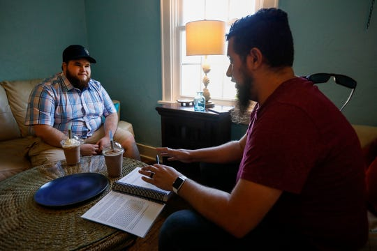 Garrett Foell, left, listens to his life coach Jeff Bryant during their meeting at Potter's House on Thursday, May 16, 2019.