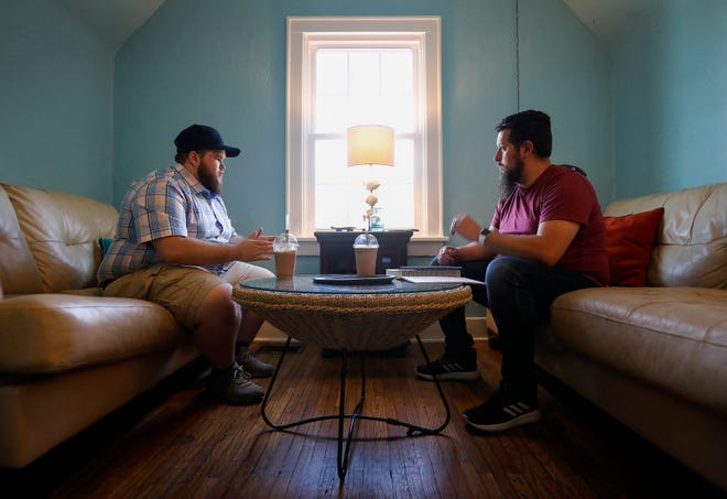 Garrett Foell, left, talks with his life coach Jeff Bryant during their meeting at Potter's House on Thursday, May 16, 2019.