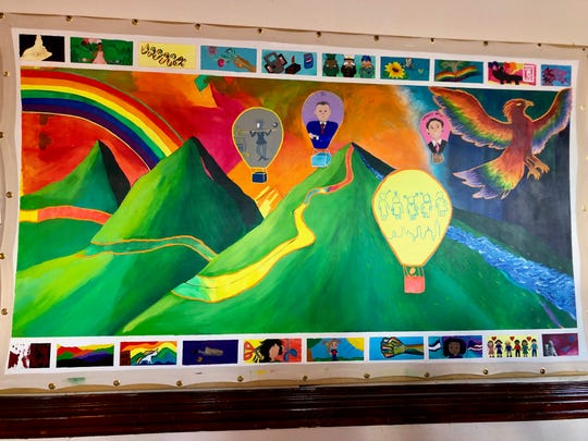 This mural, displayed at the Shenandoah LGBTQ Center on May 14, 2019, depicts the history of the LGBT movement at large.