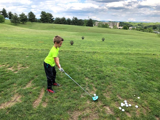 Benny Crawford, 7, prepares to tee off during practice at the Club at Ironwood Wednesday afternoon as part of the First Tee golf instructional program.
