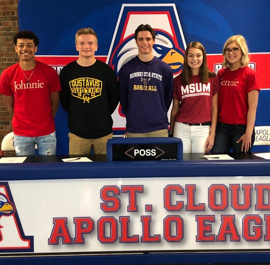 Apollo seniors (from left) Lukas Theisen (St. John's football and baseball); Isaac Erickson-Thoemke (Gustavus football); Isaac Benesh (Minnesota State-Mankato baseball), Briana Cornell (MSU-Moorhead dance team) and Ariana Abraham (St. Benedict dance team) all participated in a college signing ceremony Thursday.