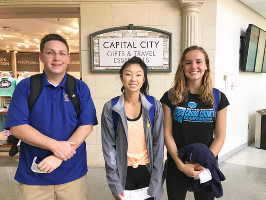 TCC athletic director Rob Chaney, Mia Wiederkehr (center) and Genevieve Printiss hang out at Tallahassee International Airport before leaving for Hobbs, New Mexico. Wiederkehr and Genevieve will compete at the NJCAA Outdoor Track & Field National Championships.