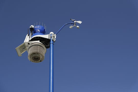 The WeatherSTEM weather station at Apalachee Park is painted blue and sports the Visit Tallahassee and Leon County logos.