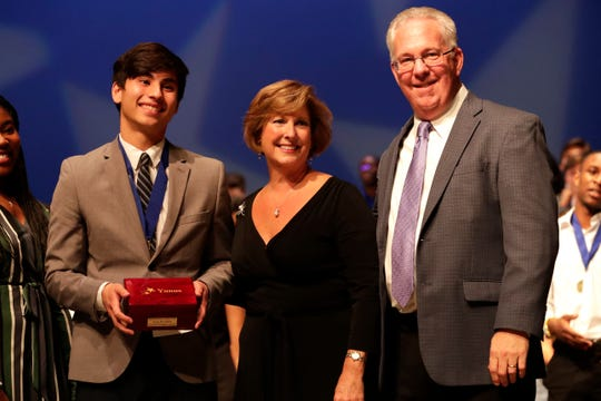 Yunus Kovankaya, a senior at Lincoln High School, left, receives the Spirit of the Best and Brightest Award. Leon County high school seniors are recognized at the 14th Annual Best & Brightest Awards Ceremony Wednesday, May 15, 2019.  Outstanding students are awarded scholarships for their leadership skills, academic accomplishments and community service involvement.