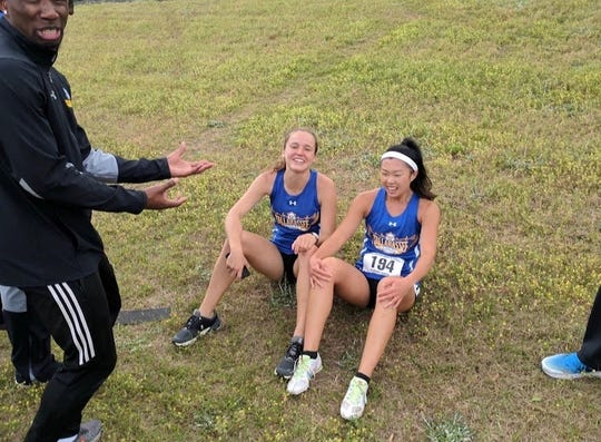Genevieve Printiss (left) and Mia Wiederkehr are all smiles after qualifying for nationals at the Alice Coachman Invitational on March 30 at Albany State University.