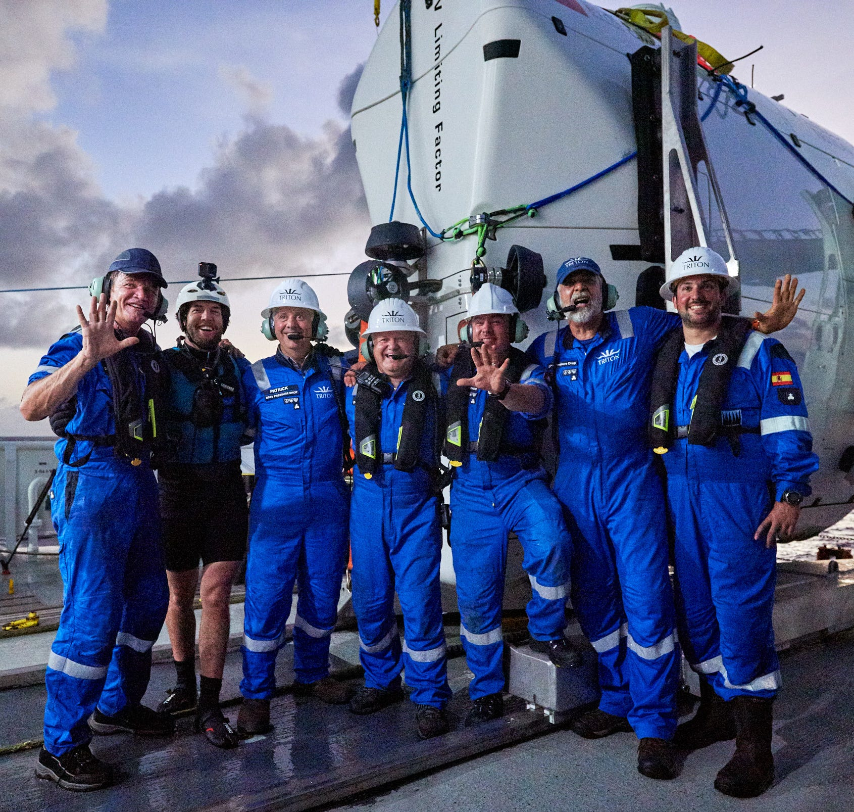 Left to right, Steve Chappelle, Tim Macdonald, Patrick Lahey, Kelvin Magee, Shane Eigler, Frank Lombardo and Hector Salvador, all crew members of Triton Submarines in Sebastian, celebrate DSV Limiting Factor's fifth dive into the depths of the Mariana Trench near Guam in the Pacific Ocean.