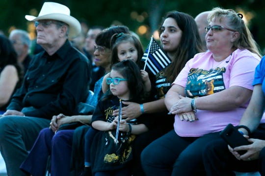 Catalina Barraza holds her daughters Madyson and Melody next to her mom Tammy Avent, right, during the Blue Light Vigil as part of National Police Week Wednesday, May 15, at Chamizal National Memorial. The Barraza family attended in memory of agent Jose Daniel Barraza.