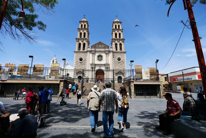People walk towards the Cathedral of Ciudad Juárez for a tour of the Catedral de Nuestra Se–ora de Guadalupe during the Juarez historic walking tour Thursday, May 16, in Juárez.