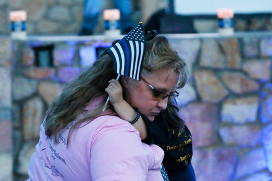 Tammy Avent holds her granddaughter Madyson Barraza during the Blue Light Vigil as part of National Police Week Wednesday, May 15, at Chamizal National Memorial. The Barraza family attended in memory of agent Jose Daniel Barraza.