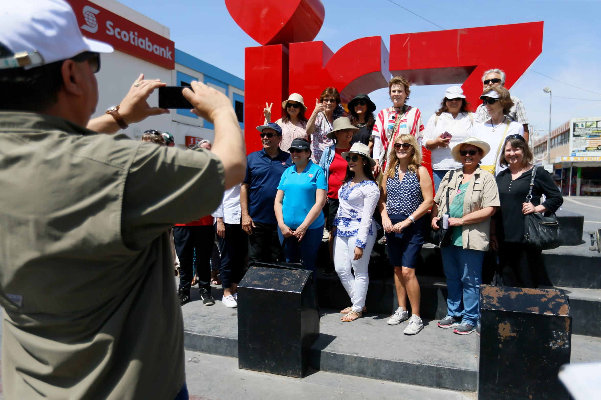 The tour group takes a photo during the Juárez historic walking tour lead by El Paso's first lady Adair Margo Thursday, May 16, in Juárez.