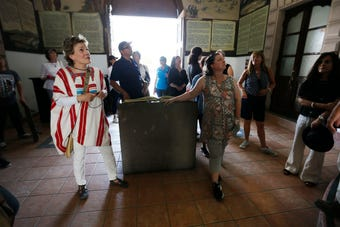 People attend the Juárez historic walking tour lead by El Paso's first lady Adair Margo Thursday, May 16, in Juárez.