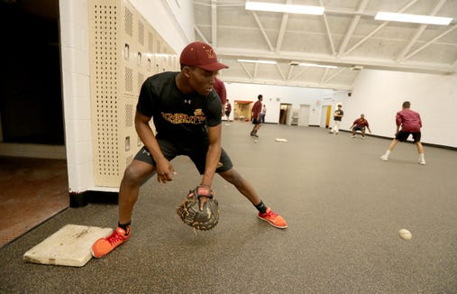 Dahved Lyttle, a senior on the Mount Vernon High School baseball team, practices with his team in a converted locker room May 16, 2019. Without a field to play on, the  baseball team has had to practice indoors all season long and play all their games at opposing schools. The new field will be ready for play in time next baseball season.