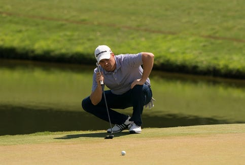 Brian Mackey reads his putt on the 15th hole on the East Course during the second round of the 52nd PGA Professional Championship at Belfair on April 29, 2019 in Bluffton, South Carolina.