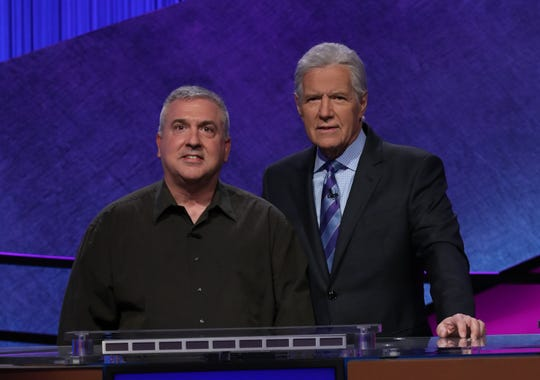 Francois Barcomb of Gardiner, a teacher at Hendrick Hudson High School in Montrose, competes in the Jeopardy! Teacher Tournament. He's pictured here with Jeopardy! host Alex Trebek.