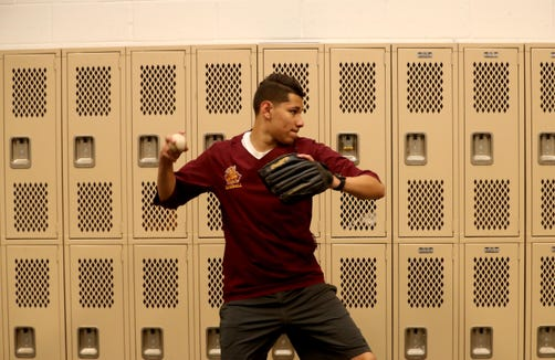 Aly Alvarez, a senior on the Mount Vernon High School baseball team, practices with his team in a converted locker room May 16, 2019. Without a field to play on, the  baseball team has had to practice indoors all season long and play all their games at opposing schools. The new field will be ready for play in time next baseball season.