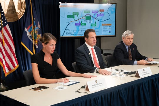Governor Andrew M. Cuomo holds a press briefing on his meeting with President Trump to discuss infrastructure priorities, including the Gateway Tunnel. Melissa DeRosa, Secretary to the Governor, left and Rick Cotton, Port Authority, right.