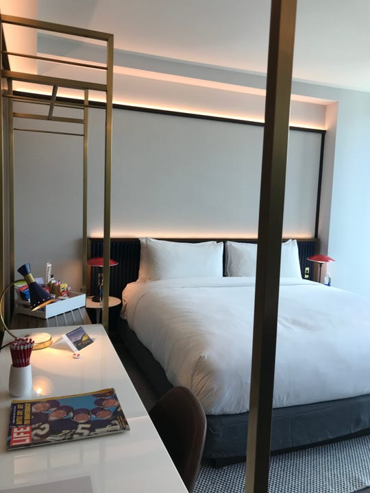 The hotel room at the TWA Hotel is fitted with retro furniture and accessories including a Life Magazine on every desk.