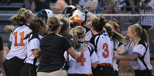 In this file phote from May 25, 2013, Kaylea Armstrong is mobbed by her teammates at home plate after she hit a game-winning three-run home run to beat Kennedale in the Region I-4A finals.