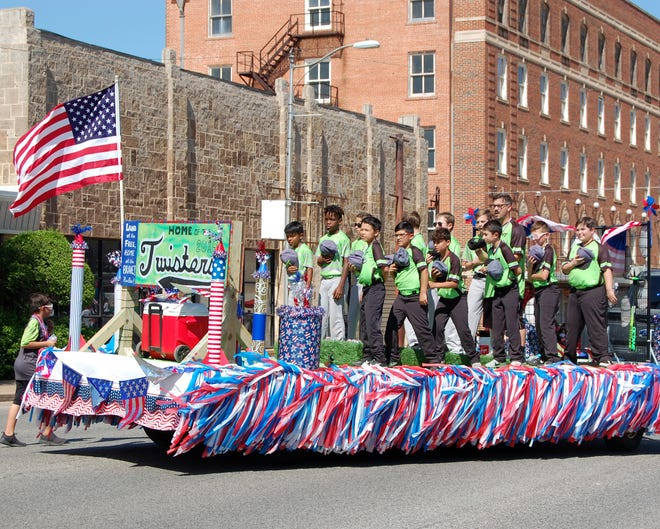 """A float featuring the Vernon Twister Baseball team titled """"America's Past Time"""" was awarded the Sweepstakes Trophy as the best display of parade theme as well as first place in the competitive division. The team stood with hands across their chests as the National Anthem was played. The parade was the official kick-off for nightly performances of the 74th annual Santa Rosa Rodeo held this week."""