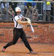 In this file photo from May 25, 2013, Burkburnett batter Kaylea Armstrong hits a game-winning three-run home run during a Region I-3A playoff win versus Kennedale in Bridgeport.