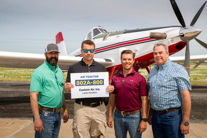 Michael Hutchins, second from left, recently became the owner of the 800th AT-802 aircraft released by manufacturer Air Tractor of Olney, Texas. Pictured with Hutchins, left,  Air Tractor Sales Coordinator Chris Lockhart; second from right, Logan Lane of Lane Aviation; and Air Tractor President Jim Hirsch.