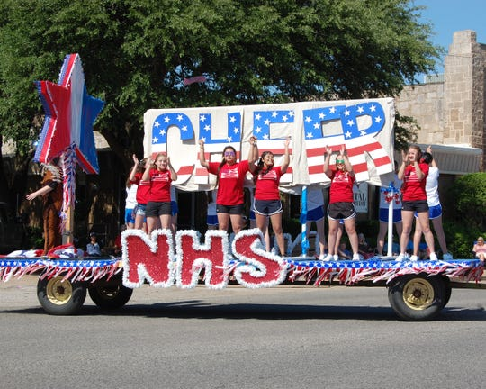 "The Northside High School float entry in Wednesday's Santa Rosa Roundup parade had the simple theme of ""Cheer"". Theme for the parade was ""Three Cheers for the Red White and Blue."""