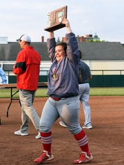 Sheridan senior Morgan Grosse holds up the district championship trophy after the Generals earned a 10-1 win against Waverly in a Division II district final on Wednesday at Ohio University.