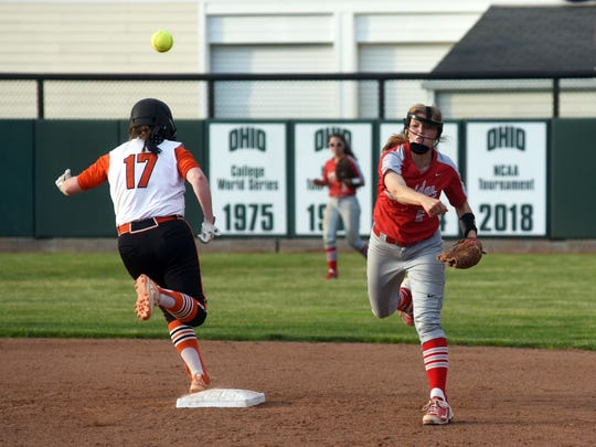 Kaitlyn Sturgeon, Sheridan's shortstop, fires a throw to first place to complete a double play against Waverly.