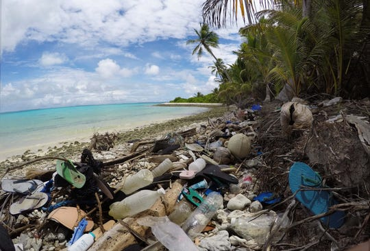 Mounds of garbage washed up on the shores of Direction Island, one of the Cocos Islands in the Indian Ocean.