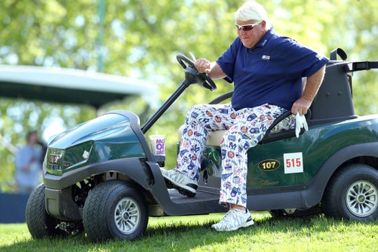 John Daly gets out of his cart on the third hole during the first round of the PGA Championship.