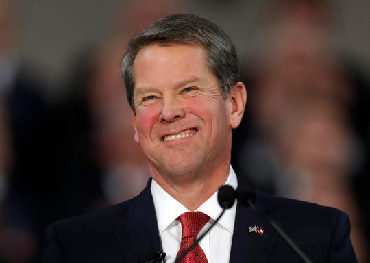 FILE - In this Jan. 14, 2019, file photo, Gov. Brian Kemp speaks after being sworn in as Georgia's governor during a ceremony at Georgia Tech's McCamish Pavilion in Atlanta. Kemp has delayed an annual trip to Los Angeles to promote Georgia's film industry as movie executives, producers and actors criticize the state's new abortion ban. (AP Photo/John Bazemore, File)